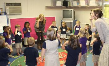 NEW SCHOOL PROGRAM - Students at Central Rayne Kindergarten participate the new Do-Re-ME! program, one of three schools in Acadia Parish selected for participation as instructed by the Acadiana Symphony Orchestra and Conservatory of Music. Instructor for the weekly class is Christine Balfa, left, and her assistant, Alyce Ray, right.