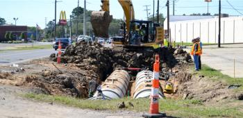 Department of Transportation and Development workers bury a dual culvert underneath the side of westbound lane of Oddfellows Road. The culverts will be paved over to create a turn lane for drivers headed north on Parkerson Avenue/Hwy. 13.