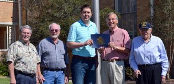 On hand for the Attakapas Chapter Sons of the American Revolution's presentation of a Flag Certificate to First Baptist Church were, from left, Associate Pastor Larry Evans, Brotherhood member Ron Lawson, Pastor Cullen Clark and Bill McCain and T. J. Fontenot, co-chairmen of the Attakapas Chapter's Flag Committee.