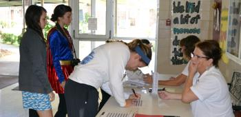 Students sign in to vote.