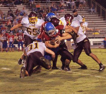Iota's Nick Sloane and a host of defenders bring down a Lake Arthur running back during the Bulldogs' 16-14 loss to the Tigers Friday evening.