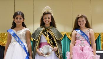 JUNIOR QUEEN CROWNED - Payton Broussard (center) was named the 2013-2014 Frog Festival Junior Queen during the Saturday morning pageant sponsored by the ladies of Preceptor Alpha Chi Chapter of Beta Sigma Phi. Court members include 1st Alternate Kailey Hollier, left, and 2nd Alternate Kyleigh Curlee, right.