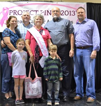 Joining the newly named 2013-2014 Project Pink Ambassador, Janet Boudreaux, during the 2013 Annual Project PInk were her family members, from left, Cassie, Johann, Jules and Greyson Ronkartz, honoree and her husband, Roland Boudreaux, and Jeffery Ronkartz. Absent from photo were family members Brian, Trusy, Thomas, Matthew and John Ronkartz.