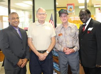Classmates of the Rayne High School graduating class of 1943 welcomed during the annual alumni reception for Homecoming 2013 were, from left, RHS principal Wendell Prudhomme, classmates Ted Doucet and W.F. Laurents, and former RHS principal James Proctor.