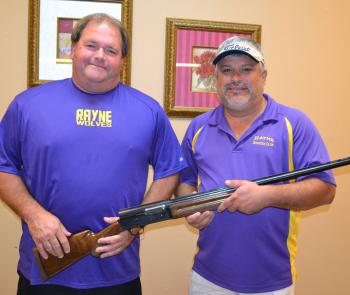 The Rayne Boosters are completing plans for the 3rd Annual Sporting Clay Shoot and Auction on Saturday, Oct. 26, at Ed's Shooting Range in Kaplan. Displaying the Beretta shotgun being offered during a raffle drawing are event co-chairmen Greg Doré (250-5598), left, and Blake Alleman (581-0017), right.