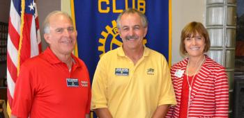 """The Rotary Club of Crowley was able to learn about David Savoie, center, and his family's """"Tiger Cruise"""" where they learned about daily operations aboard a U.S. Navy ship. Thanking him for the presentation were President Scott Shumacher, left, and Secretary M'Elise Trahan."""
