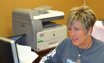 International Rice Festival Coordinator Roxie Viator sits hard at work at her desk at the International Rice Festival Office on Hutchinson Ave. Friday afternoon.  Viator has been working several extra hours in preparation for the festival which runs from Oct. 17-20.
