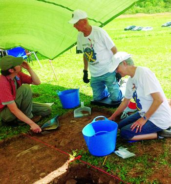 Theresa Cronan, far right, joins Steve Garcin, left, (archaelogist supervisor and project director) and Don Thibodeaux of Baton Rouge, center, (leader of the Louisiana group), during a dig at one of five home sites in an Acadie village area, presently Nova Scotia.