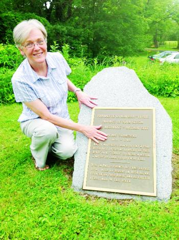 Theresa Hebert Cronan visits a historical marker of the grist mill of Pierre Thibodeau on the property at Pre Round of Acadie, the present-day Nova Scotia.