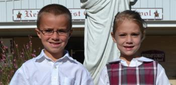From left, first graders Cohen Herpin, prince, and Elizabeth Hensgens, princess, were selected to represent Redemptorist Catholic School in the 2013 Rice Festival Junior King and Queen's Contest. Cohen is the son of Jason Herpin and Sadie Maddocks and Elizabeth is the daughter of Charles and Cathy Hensgens.